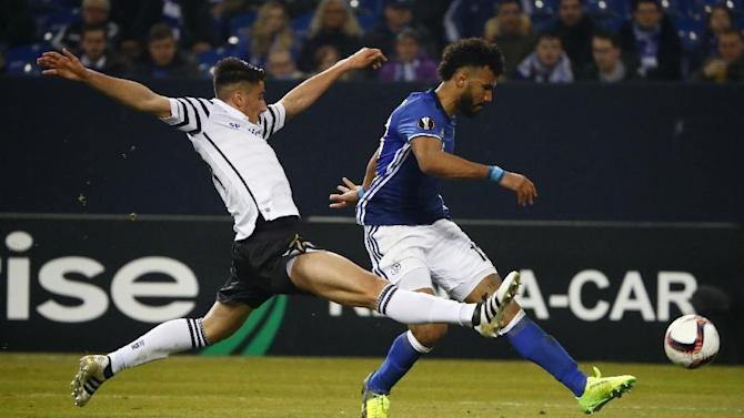 PAOK's Achilleas Poungouras in action with Schalke's Eric Maxim Choupo-Moting