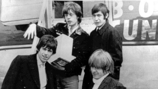 "FILE - In this April 22, 1965 file photo, British rock and roll group, The Rolling Stones, arrive at Montreal Airport. They are Mick Jagger, top left, Charlie Watts, top right, Keith Richards, middle left, Brian Jones, middle right, and Bill Wyman. The Cleveland-based The Rock and Roll Hall of Fame Museum will open ""Rolling Stones: 50 Years of Satisfaction,"" an exclusive exhibit celebrating the archetypal rock band, on May 24, 2013. (AP Photo, File)"