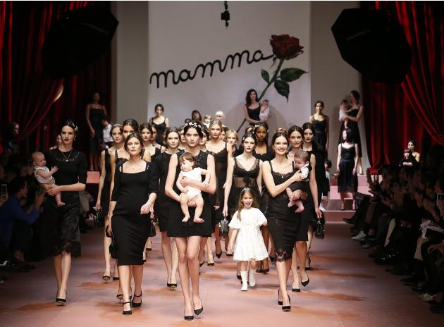 Model Bianca Balti joins other models as they present creations from the Dolce & Gabbana Autumn/Winter 2015/16 collection during Milan Fashion Week