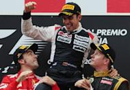 (L-R) Ferrari's Spanish driver Fernando Alonso, William's Venezuelan driver Pastor Maldonado and Lotus F1 Team's Finnish driver Kimi Raikkonen celebrate on the podium at the Circuit de Catalunya on May 13, 2012 in Montmelo on the outskirts of Barcelona during the Spanish Formula One Grand Prix. Maldonado drove to a dramatic victory on Sunday, becoming the first Venezuelan to win a Formula One race