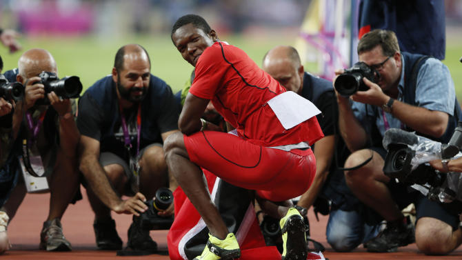 Trinidad and Tobago's Keshorn Walcott smiles to the photographers after winning gold in the men's javelin throw final at the London 2012 Olympic Games at the Olympic Stadium