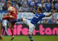 Bayern Munich's midfielder Toni Kroos (L) and Schalke's midfielder Jermaine Jones fight for the ball during their German first division Bundesliga football match in Gelsenkirchen, western Germany. Bayern won 2-0