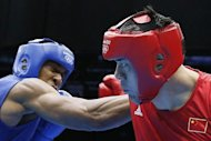 Zhilei Zhang of China (in red) defends against Anthony Joshua of Great Brintain during their Super heavyweight (+91kg) boxing quarter-finals of the 2012 London Olympic Games at the ExCel Arena, on August 6. Joshua became the fourth British boxer to reach the semi-finals and said the hunger for medals in London is driving on the home team