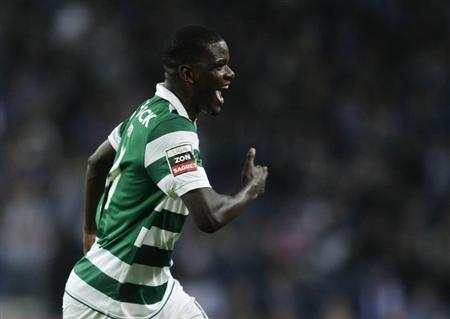 Sporting Lisboa's William Carvalho celebrates his goal against Porto during their Portuguese premier league soccer match in Porto
