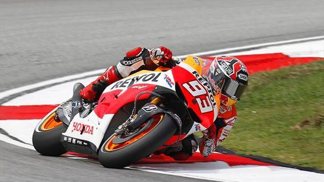 Motorcycling - Marquez takes pole ahead of Rossi