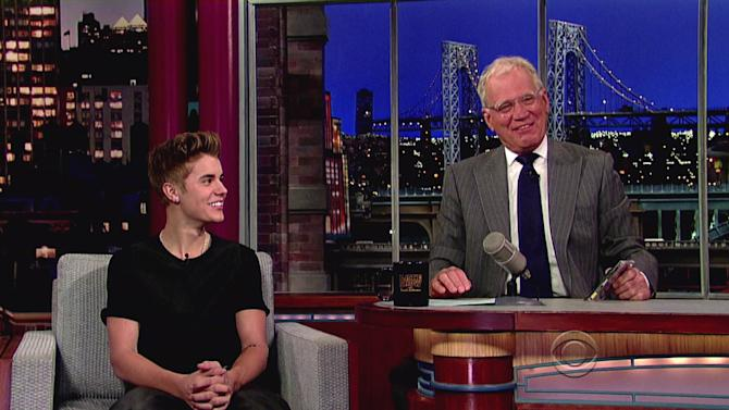 Justin Bieberpromotes his new album 'Believe' and mentions the new tattoo he got on his arm, which Letterman objected to, during an appearance on CBS's 'Late Show With David Letterman'USA - 21.06.12Supplied by WENN.comWENN does not claim any ownership including but not limited to Copyright or License in the attached material. Any downloading fees charged by WENN are for WENN's services only, and do not, nor are they intended to, convey to the user any ownership of Copyright or License in the material. By publishing this material you expressly agree to indemnify and to hold WENN and its directors, shareholders and employees harmless from any loss, claims, damages, demands, expenses (including legal fees), or any causes of action or  allegation against WENN arising out of or connected in any way with publication of the material.