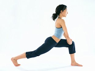 woman stretching in fitness clothes