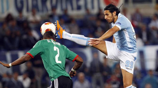Legia Warsaw's Dossa Junior challenges Lazio's Floccari during their Europa League soccer match in Rome