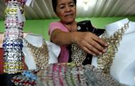 A worker arranges products made with push-tabs from aluminum beverage cans at the Philippine Christian Foundation building in Manila on June 13. In the midst of the Philippines' most notorious slum, British expat Jane Walker transforms lives by turning rubbish into top-end fashion items
