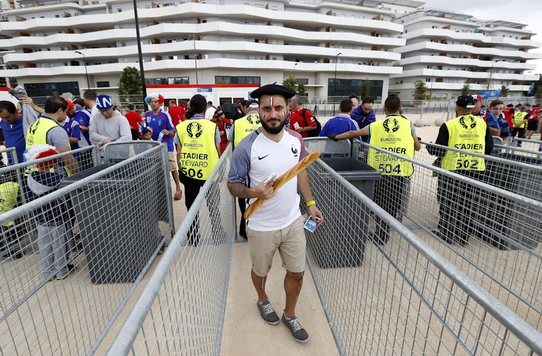 France fan outside the stadium before the match
