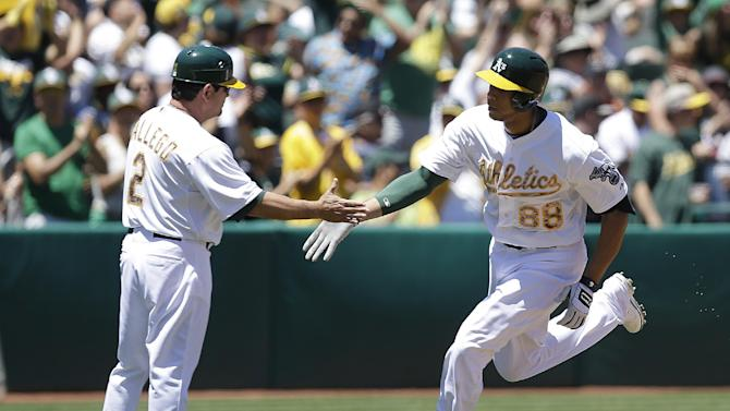 A's snap 4-game skid with 10-0 win over Tigers