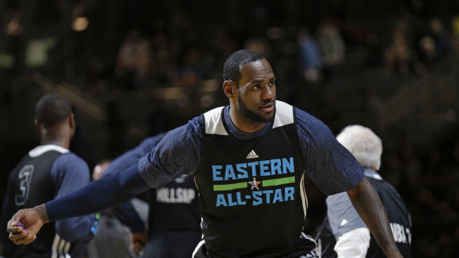 East Team's LeBron James, of the Miami Heat, throws a pair of Mardi Gras beads to the crowd during NBA All-Star game basketball practice in New Orleans, Saturday, Feb. 15, 2014