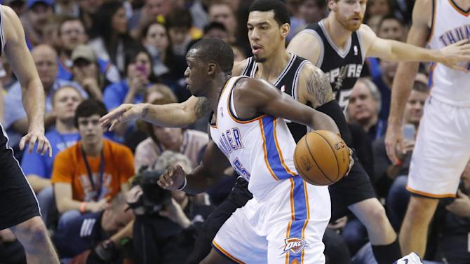 Oklahoma City Thunder guard Reggie Jackson (15) drives around San Antonio Spurs guard Danny Green (4) in the fourth quarter of an NBA basketball game in Oklahoma City, Wednesday, Nov. 27, 2013. Oklahoma City won 94-88