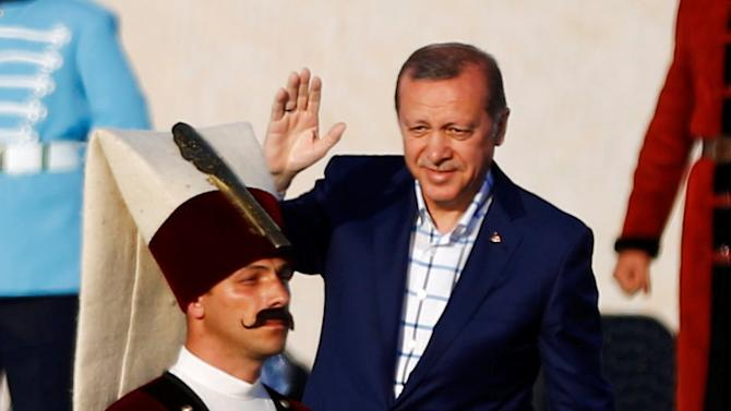 Turkish President Erdogan greets supporters during a rally to mark the 563rd anniversary of the conquest of the city by Ottoman Turks, in Istanbul