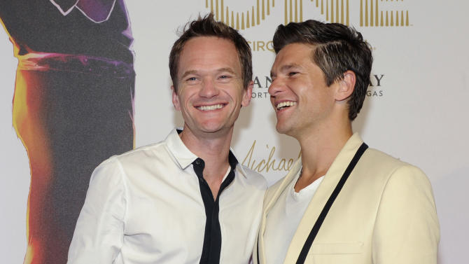 "Actor Neil Patrick Harris, left, and David Burtka arrives at the world premiere of ""Michael Jackson ONE"" at THEhotel at Mandalay Bay Resort and Casino on Saturday, June 29, 2013 in Las Vegas. (Photo by David Becker/Invision/AP)"