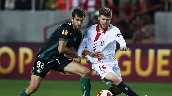 Sevilla's Moreno and Real Betis' Baptistao fight for the ball during their Europa League soccer match in Seville