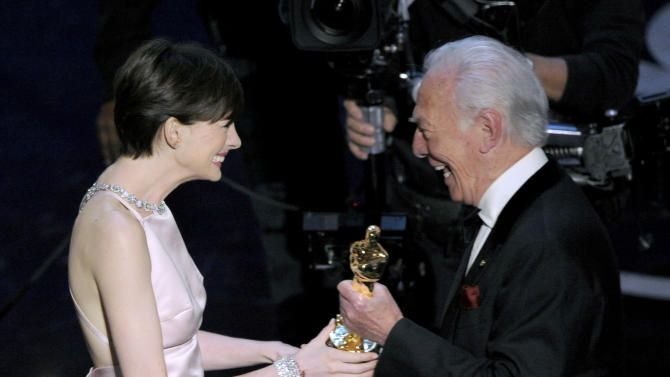 "Actor Christopher Plummer, right, presents the award for best actress in a supporting role to Anne Hathaway for ""Les Miserables"" during the Oscars at the Dolby Theatre on Sunday Feb. 24, 2013, in Los Angeles.  (Photo by Chris Pizzello/Invision/AP)"