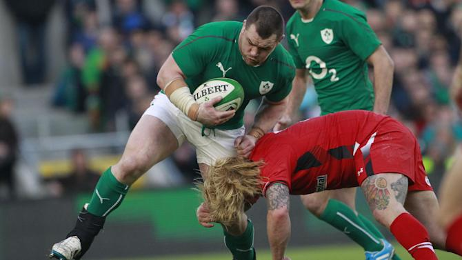 Ireland's Cian Healy, centre, is tackled by Wales' Richard Hibbard during their Six Nations Rugby Union international match at the Aviva Stadium, Dublin, Ireland, Saturday, Feb. 8, 2014. (AP Photo/Peter Morrison)