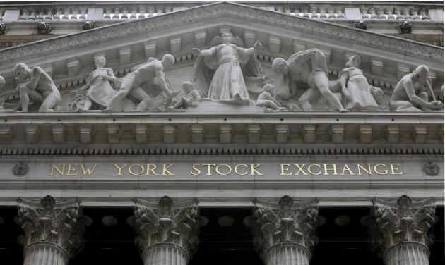 FILE - This Oct. 2, 2015 file photo shows the facade of the New York Stock Exchange, in New York. U.S. stocks are edging lower in midday trading Thursday, March 26, 2015, extending the market's losses