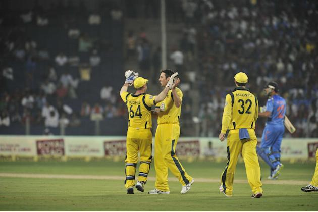 Australian players celebrate the fall of a wicket during the 1st ODI between India and Australia at Maharashtra Cricket Association Stadium, Pune on Oct. 13, 2013. (Photo: IANS)