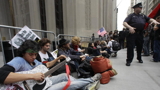 In this Sept. 17, 2011 file photo, demonstrators affiliated with the Occupy Wall Street movement gather to call for the occupation of Wall Street in New York. Monday, Oct. 17, 2012 marks the one-year anniversary of the Occupy Wall Street movement. (AP Photo/Frank Franklin II, File)