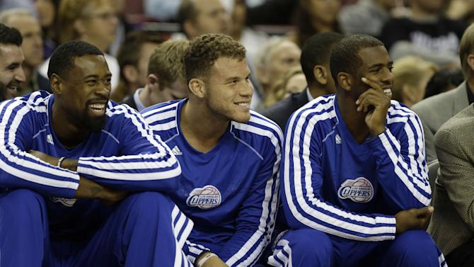 Los Angeles Clippers' DeAndre Jordan, left, Blake Griffin, center, and Chris Paul watch the the action against the Sacramento Kings during the third quarter of an NBA preseason basketball game in Sacramento, Calif., Monday, Oct. 14, 2013.   The trio did not play in the Clippers 99-88 loss to the Kings
