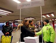 Timea Szabo(2th R), co-chair of opposition party Parbeszed Magyarorszagert hands over documents with signatures supporting a referendum on Budapest's 2024 Olympic bid to political movement Momentum at a stand in Budapest, Hungary, February 16, 2017.Picture taken February 16, 2017. REUTERS/Laszlo Balogh