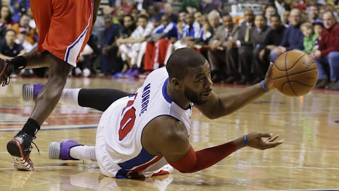 Detroit Pistons forward Greg Monroe (10) passes the ball during the first half of an NBA basketball game against the Los Angeles Clippers in Auburn Hills, Mich., Monday, Jan. 20, 2014