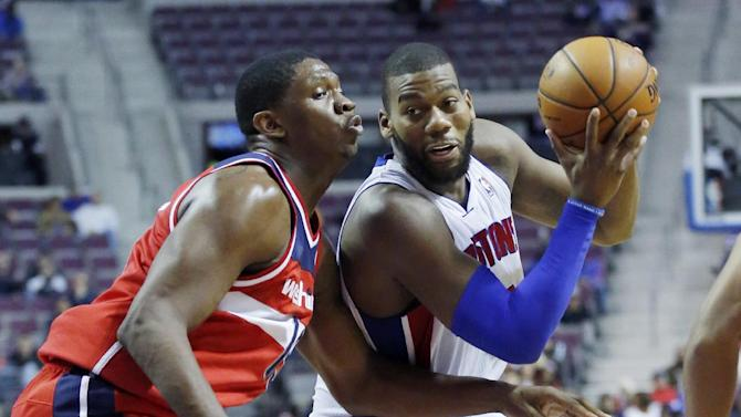 Detroit Pistons center Greg Monroe (10) drives to the basket against Washington Wizards forward Kevin Seraphin (13) during the second half of a preseason NBA basketball game Tuesday, Oct. 22, 2013, in Auburn Hills, Mich. Monroe led the Pistons with 18 points in a 99-96 win