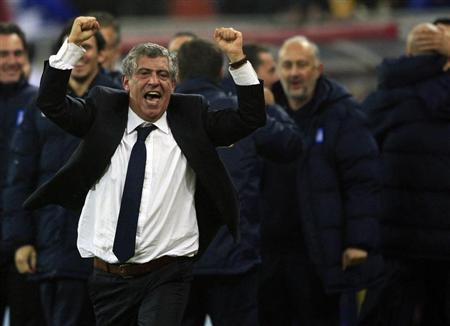 Greece's head coach Santos celebrates defeating Romania during their 2014 World Cup qualifying soccer match in Bucharest