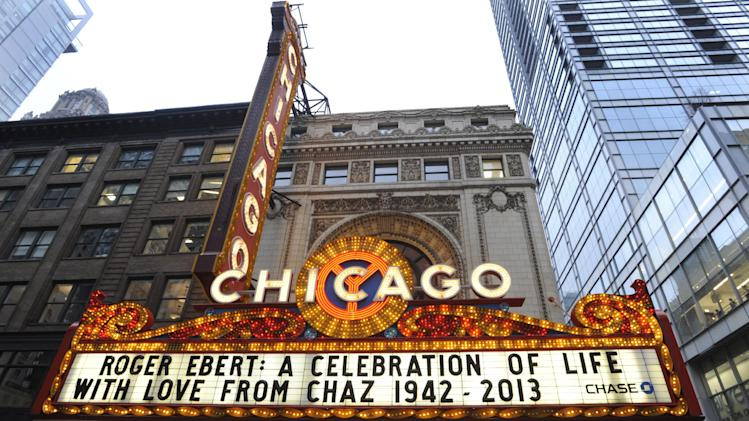 The Chicago Theater marquee before a memorial for film critic Roger Ebert in Chicago, Thursday, April 11, 2013. The Pulitzer Prize winning critic died last week at the age of 70 after a long battle with cancer. (AP Photo/Paul Beaty)
