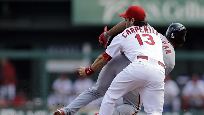 St. Louis Cardinals second baseman Matt Carpenter (13) loses the ball and his glove as Washington Nationals' Denard Span steals second base during the first inning of a baseball game Wednesday, Sept. 25, 2013, in St. Louis