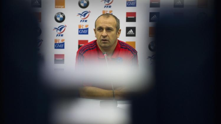 France's rugby team coach Saint-Andre holds a news conference before a training session at the Rugby Union National Centre in Marcoussis, south of Paris