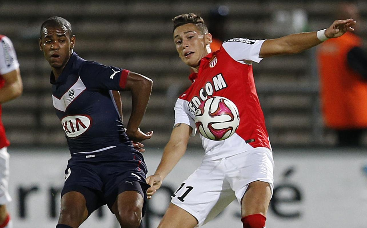 Diego Rolan Silva of Girondins Bordeaux fights for the ball with Lucas Ariel Ocampos of Monaco during their French Ligue 1 soccer match in Bordeaux