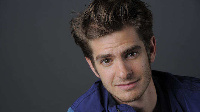 "In this Friday, July 19, 2013 photo, actor Andrew Garfield poses for a portrait on Day 3 of Comic-Con International in San Diego. Garfield stars in ""The Amazing Spider-Man 2,"" set for release next year. (Photo by Chris Pizzello/Invision/AP)"