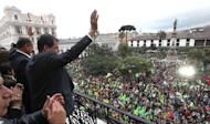 Ecuadorean President Rafael Correa waves to supporters as he celebrates his re-election, at Carondelet presidential palace in Quito on February 17, 2013. If the activist-leftist can secure an absolute majority in Ecuador's National Assembly he would have free rein to regulate the media, redistribute land and make other controversial changes