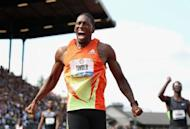 Michael Tinsley celebrates after winning the men's 400m hurdles final at the US Olympic Track and Field Trials on July 1. Tinsley was a shock 400m hurdles winner in 48.33, booking a surprise trip to his first Olympics at age 28