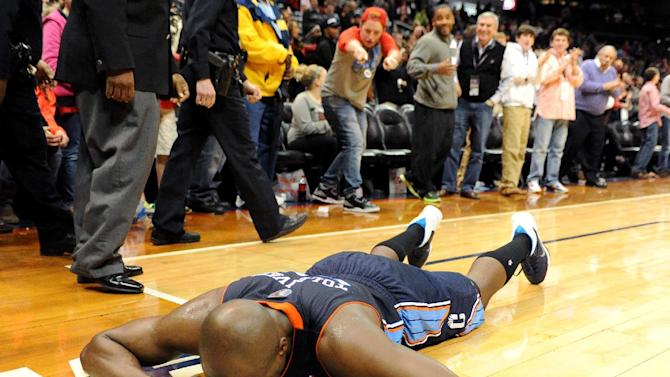 Charlotte Bobcats' Anthony Tolliver (43) falls to the ground and clenches his fists as time runs out in overtime against the Atlanta Hawks, his former team, while Atlanta holds on to win their NBA basketball game 118-116 on Saturday, Dec. 28, 2013, in Atlanta