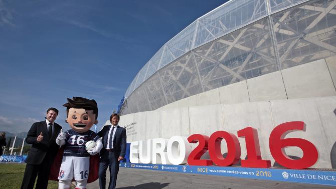 Mayor of Nice Estrosi and former soccer player Bravo pose with the official Mascot, Super Victor, for the upcoming Euro 2016 soccer championship after unveiling the UEFA Euro 2016 logo at the Allianz Riviera stadium in Nice