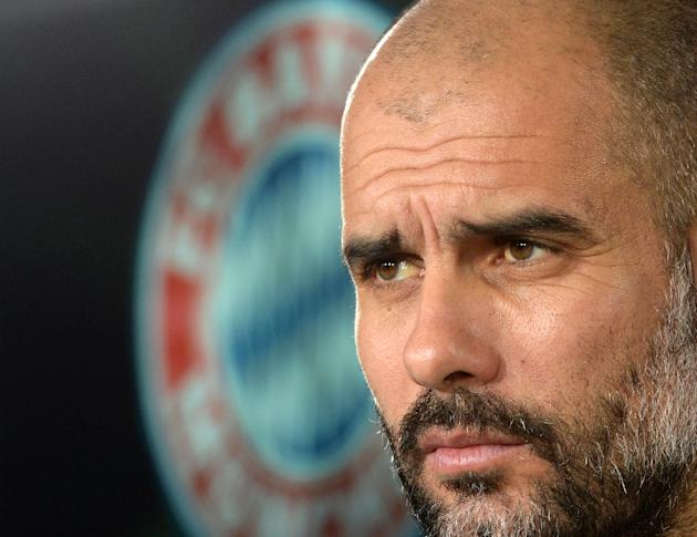 Bayern Munich's Spanish headcoach Pep Guardiola attends a press conference in Munich, Germany, on December 9, 2014
