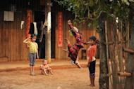Ethnic Koe Kant children play in front of their house at a village near Lashio, northern Shan state, in March. The United States on Wednesday ruled out an immediate end to its main sanctions on Myanmar, saying it wanted to preserve leverage to push the regime on ending ethnic violence and other key issues