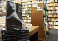"""Copies of the book """"Fifty Shades of Grey"""" by EL James are displayed at the Politics and Prose Bookstore in Washington, DC. With nearly 40 million copies sold, the erotic romance spiced up with sado-masochism is well on its way to breaking all the records"""