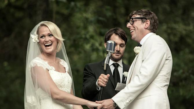 """This Saturday, Sept. 15, 2012 photo released by Joshua Black Wilkins shows Patrick Carney of The Black Keys, right, with his bride Emily Ward at their wedding officiated by actor Will Forte, center, at the couple's home in Nashville, Tenn.  The Keys' publicist says the couple was joined by about 350 family and friends for the back-yard ceremony. Comedian Will Forte officiated the wedding. Ward wore a dress by Carolina Herrera and walked down the aisle to """"Crimson and Clover"""" by Tommy James & The Shondells. (AP Photo/Joshua Black Wilkins)"""