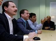 Then-Russian President Dmitry Medvedev (2ndL) meets with Arkady Volozh (1stL), CEO of Yandex, a Russian search engine company, in Palo Alto, California in 2010. Yandex turned 15 on Sunday having staved off a challenge from Google and is now coveting the elusive prize of becoming the default map provider of Apple's iconic iPhones