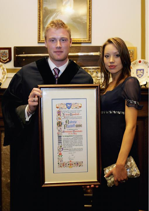 PRESTON, UNITED KINGDOM - JANUARY 20:  Andrew Flintoff of Lancashire and England poses with his scroll and his wife Rachel Flintoff during the ceremony and reception as he is granted the Freedom of th