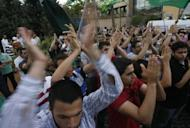 Supporters of the Sunni Muslim Jamaa Islamiya group attend a rally in central Beirut. The violence erupted hours after reports emerged that troops had shot dead Sheikh Ahmad Abdul Wahid, a prominent anti-Syria Sunni cleric, when his convoy failed to stop at a checkpoint in north Lebanon on Sunday
