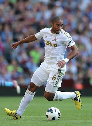 Ashley Williams has committed himself to Swansea until 2015