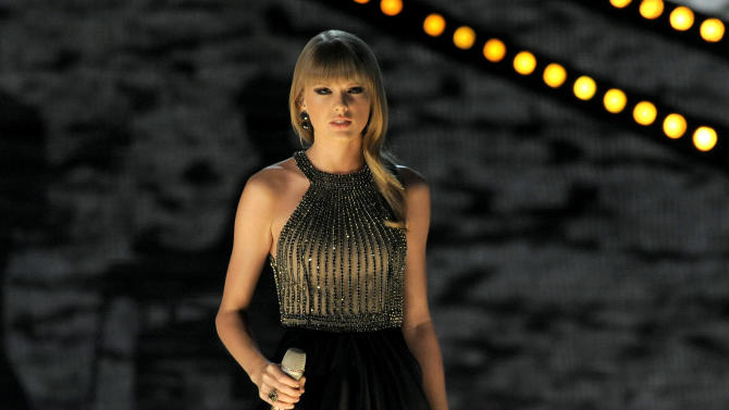 FILE - In this April 7, 2013 file photo, Taylor Swift performs at the 48th Annual Academy of Country Music Awards at the MGM Grand Garden Arena in Las Vegas. Swift, Carrie Underwood, Hunter Hayes, Little Big Town, Luke Bryan and Pistol Annies are set to perform during this year's live show at the 2013 CMT Music Awards. (Photo by Chris Pizzello/Invision/AP, File)