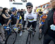 Britain's Mark Cavendish (centre) from Sky Team waits to to start the second stage of the Tour of Denmark cycling race in Logstor. Cavendish's defence of his cycling world road race title ended in disappointing fashion as he retired from the race with 111 kilometres to go