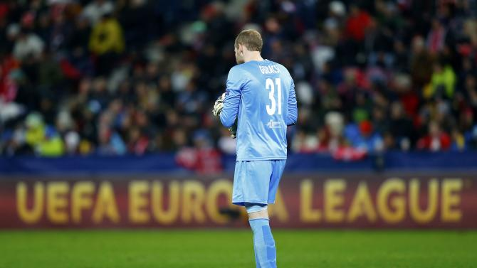 Salzburg's goalkeeper Gulacsi stands on the pitch during his team's Europa League round of 32 second leg soccer match against Villarreal in Salzburg